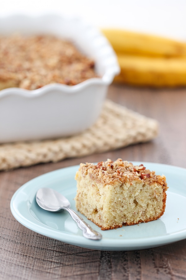 A slice of tender Banana Coffeecake on a plate with streusel topping
