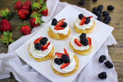 Cream Puff Pastries With Whipped Cream and Berries