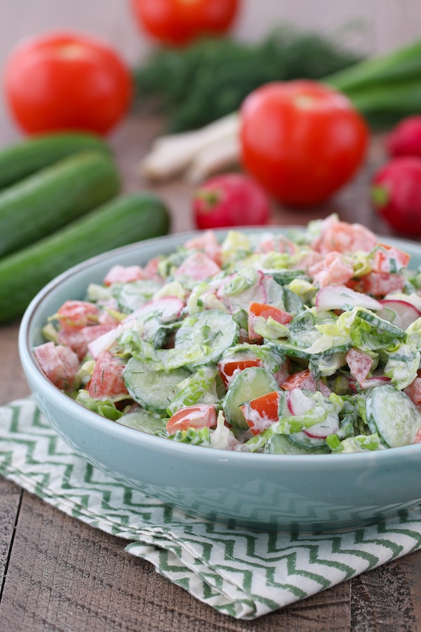 Sour Cream Vegetable Salad made with spring garden vegetables and a sour cream, dill and green onion dressing.