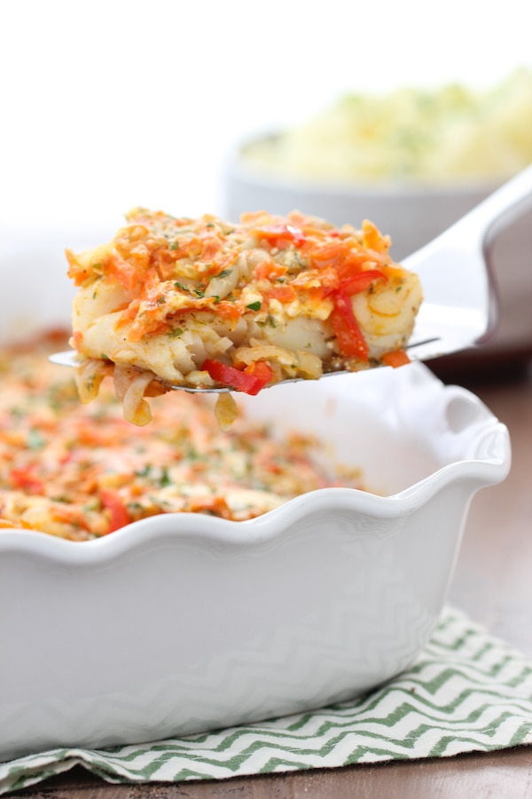Baked White Fish With Vegetables, firm white fish baked in between layers of onion, celery, carrot, pepper and tomatoes.