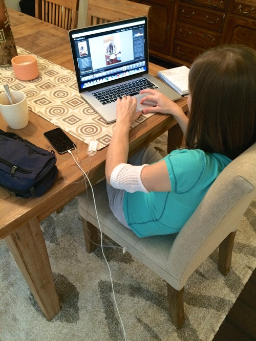 """Editing a blog post. Drinking tea, of course. That pretty blue """"purse"""" is actually my IV and pump."""