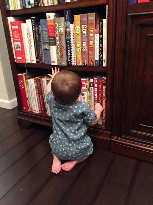 My cute niece Madeline, checking out some of my books:).