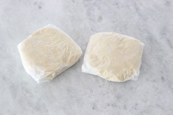 Homemade pie dough, double crust, wrapped in parchment paper