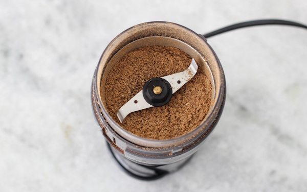 grinding coriander in the coffee grinder