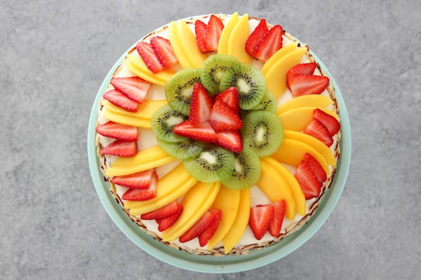 Honey Cake Topped With Fruit - Strawberries, Mangos and Kiwi