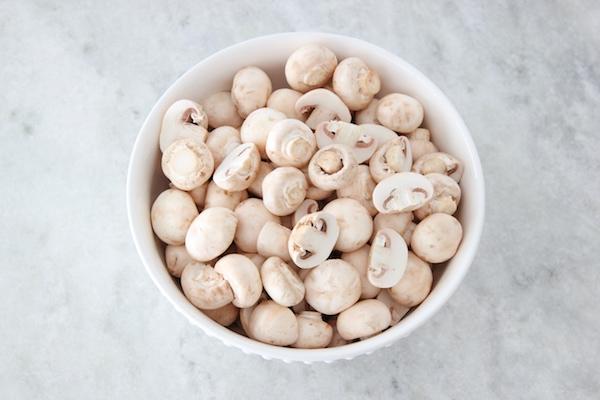 A bowl full of fresh white button mushrooms