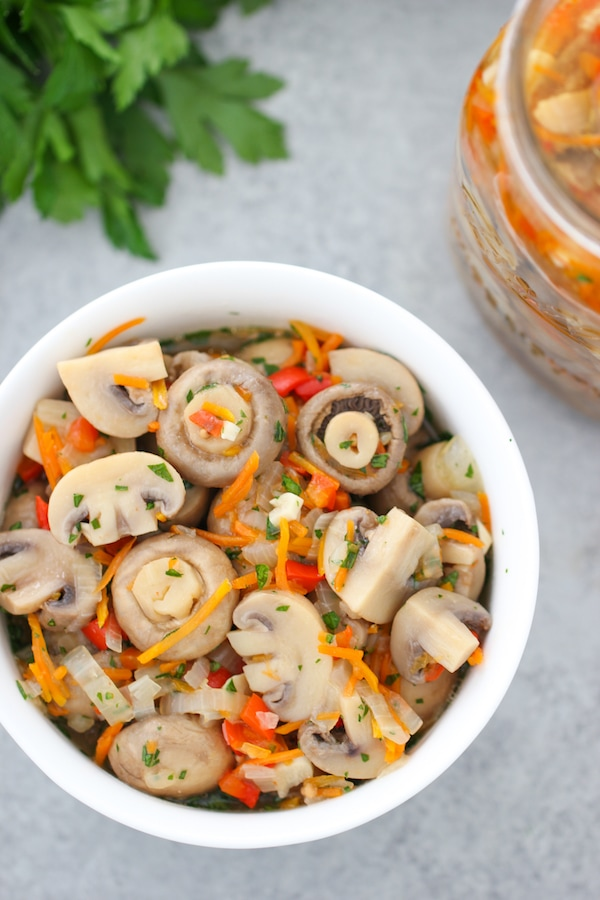 Close up shot of marinated mushrooms in a bowl