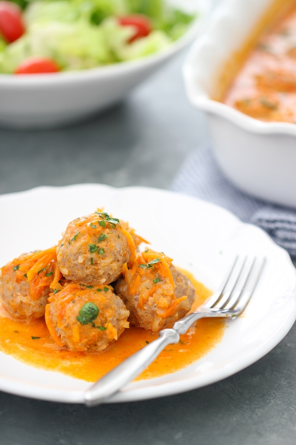 Porcupine Meatballs - beef and pork meatballs with rice and baked in a creamy tomato and vegetable sauce.