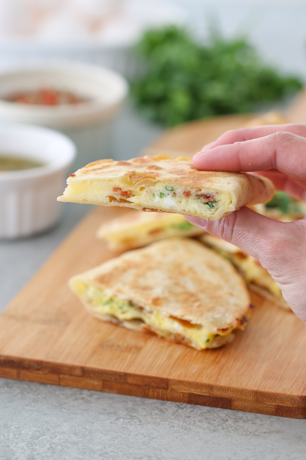 Breakfast Quesadillas filled with eggs, cheese, bacon and green onions.