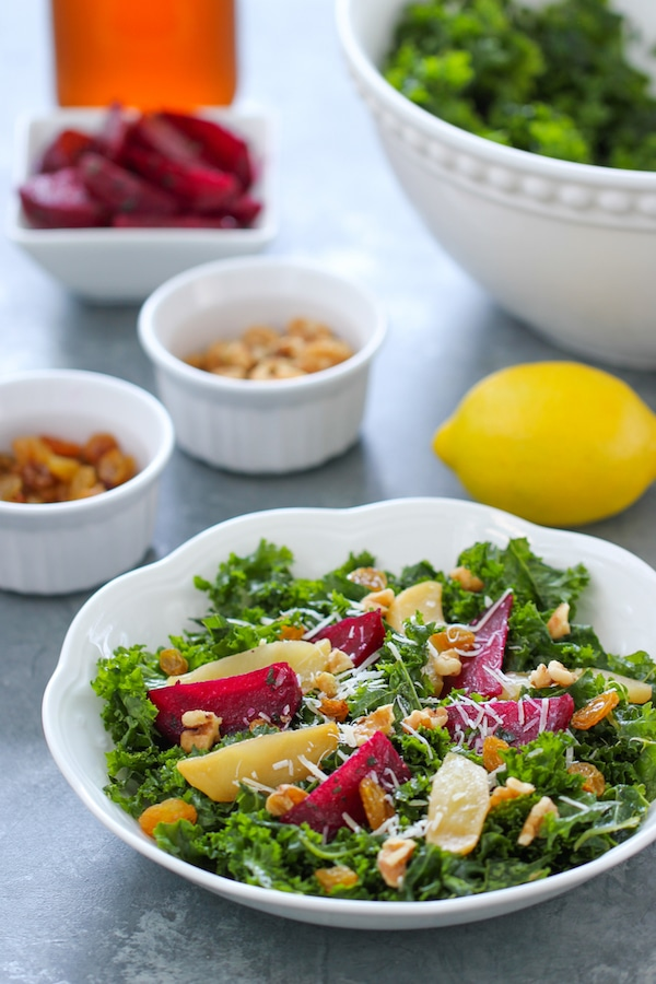Kale Salad With Roasted Beets, apples, walnuts, raisins and a garlic, apple cider vinegar and honey vinaigrette.