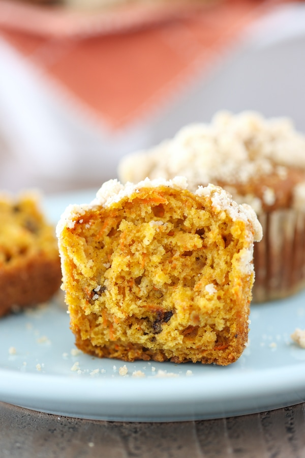 Tender and moist pumpkin muffins with grated carrot, apple and walnuts.