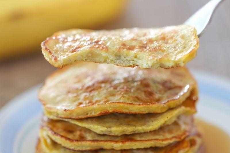 A close up, bite shot view of banana egg pancakes.
