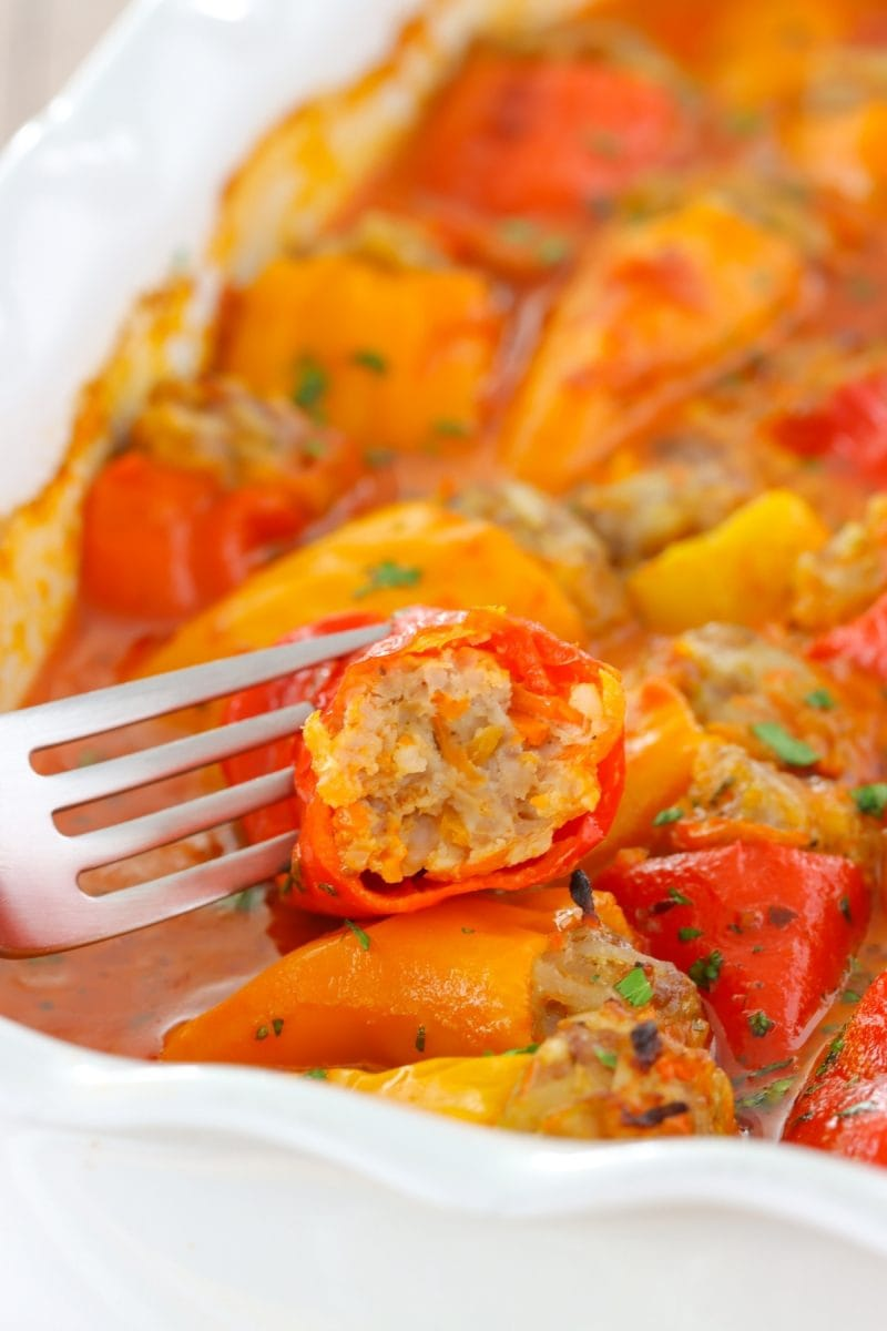 Juicy stuffed mini peppers with a ground meat and rice stuffing and baked in a creamy tomato sauce