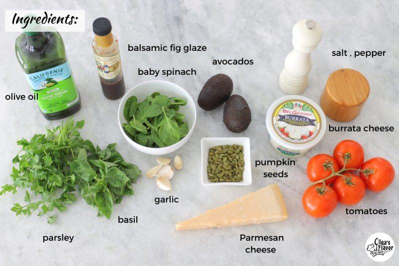 Ingredients for tomato Caprese with avocado, pesto and burrata cheese