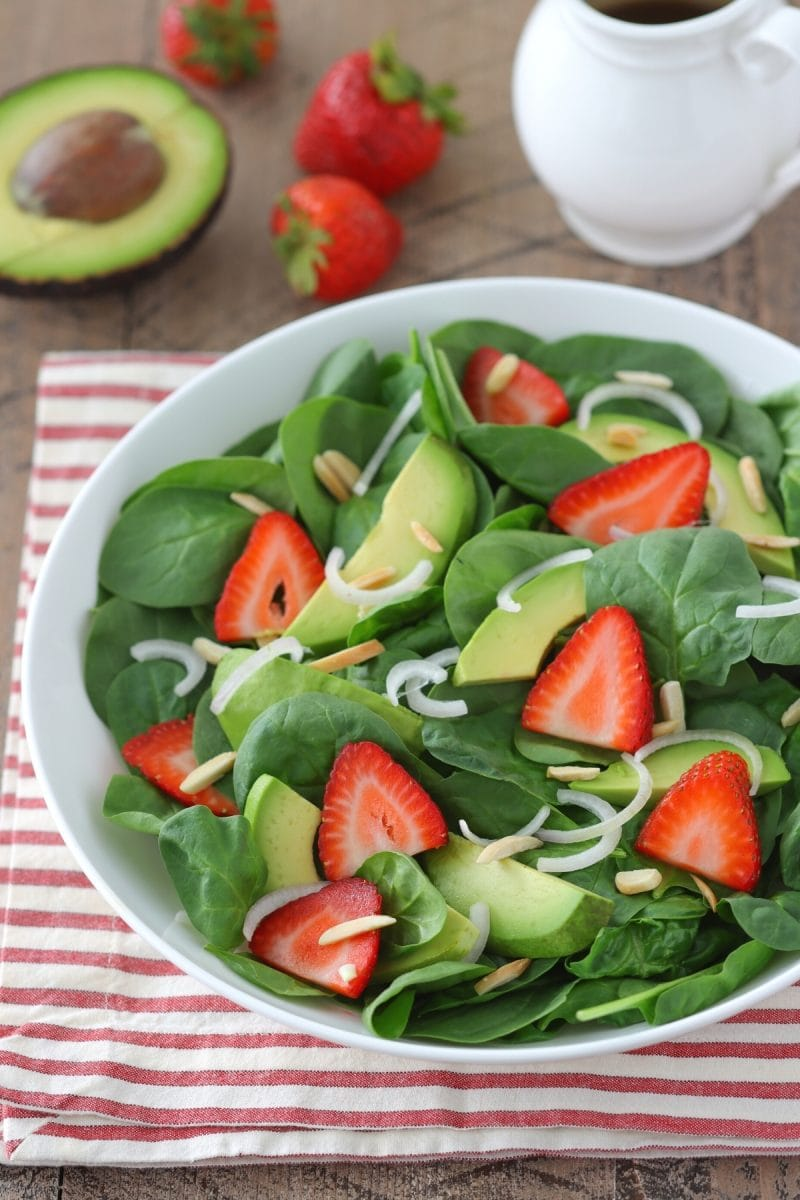 Strawberry Spinach Salad With avocados, shallot and balsamic dressing.