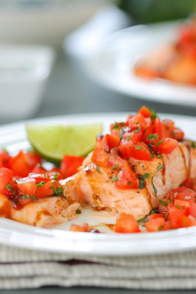 Oven Roasted Salmon - the fish is so juicy and the fresh tomato basil and garlic topping makes it beautiful and flavorful.
