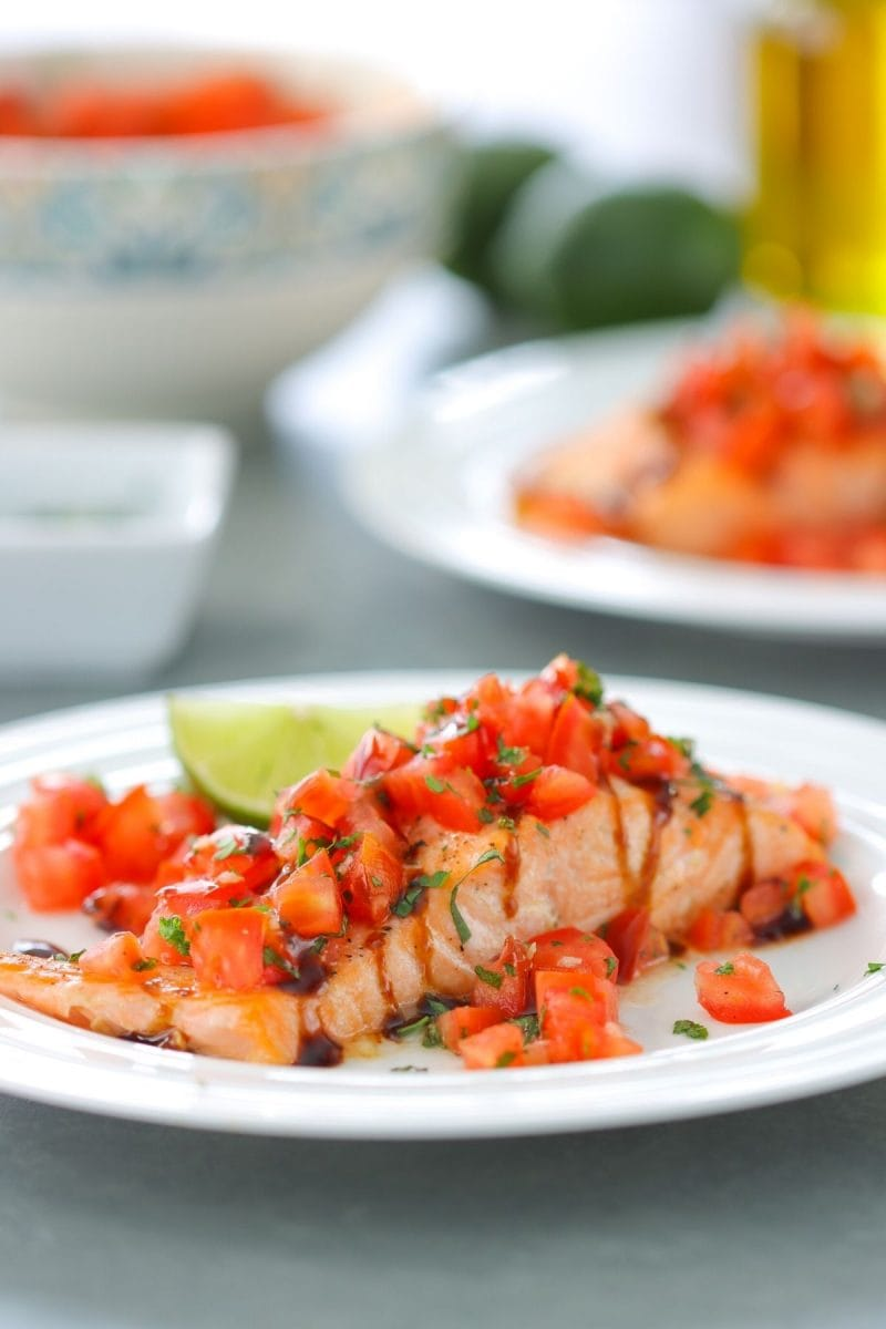 Oven Roasted Salmon with fresh tomato, basil and parsley topping.