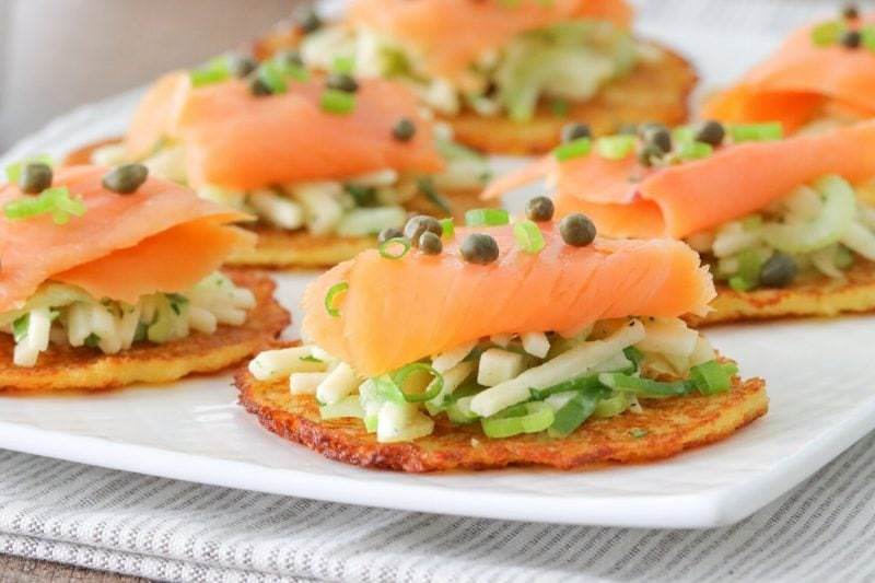 Potato pancakes with smoked salmon, apple celery slaw, capers and green onions.